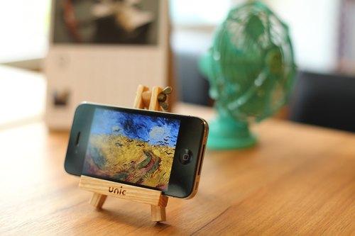 unic画架造型原木手机座