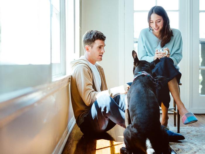 Hideaki Hamada's photography work: man, woman and dog next to bright window